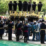 Veteran Reserve Corps unloads Lincoln's casket from Lincoln Hearse