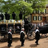 Lincoln Hearse with casket passes by the Lincoln Home